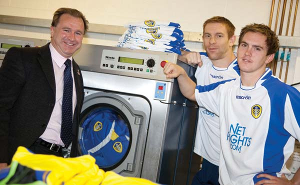 Commercial laundry machines suitable for football stadiums.